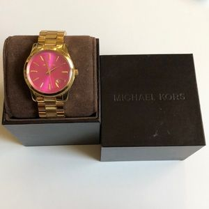 Michael Kors gold woman's watch with pink face